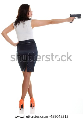Young brunette woman with gun isolated on white full lengh - stock photo