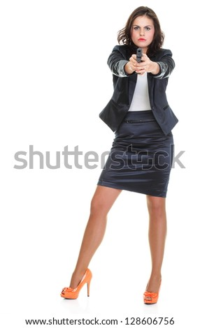 Young brunette woman with gun isolated on white full length - stock photo