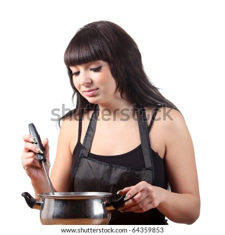 Young brunette women cooking - stock photo