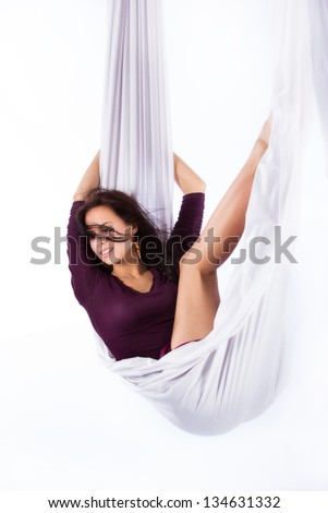 Young brunette women in a hammock - stock photo