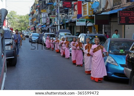 Young Buddhist nuns in the Streets of Rangoon in Myanmar, 2016 January 01 - stock photo