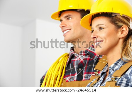 Young builder people  in yellow uniform. Over white background - stock photo