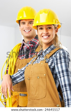 Young builder people  in yellow uniform. Over white background