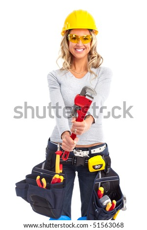Young builder woman with wrench. Isolated over white background - stock photo