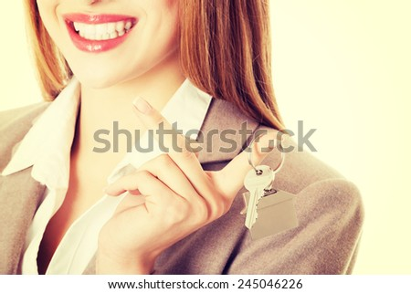 Young business caucasian woman is holding house keys.  - stock photo