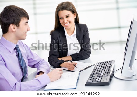 Young business collegues working in the office - stock photo