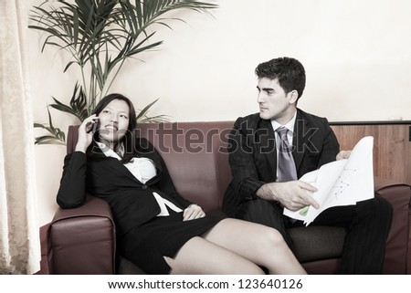 Young Business Couple on the Sofa