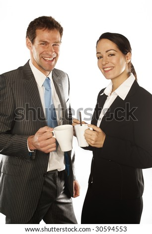 young business couple standing on white background holding a mugs coffee - stock photo