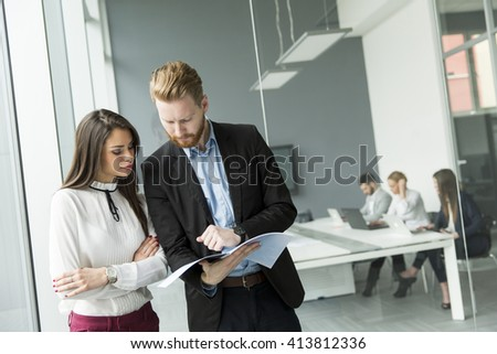 Young business couple working in the office - stock photo