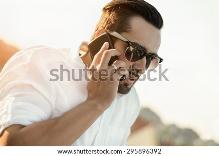 Young business executive using cell phone - stock photo