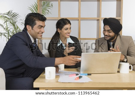 Young business executives discussing in a meeting - stock photo