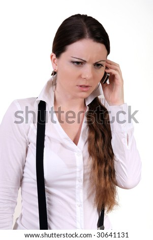 Young business girl using mobile and telephone