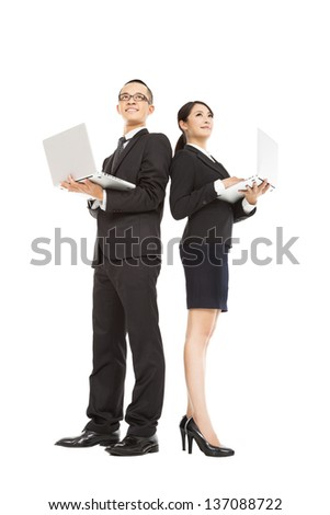 young business man and woman holding laptop - stock photo