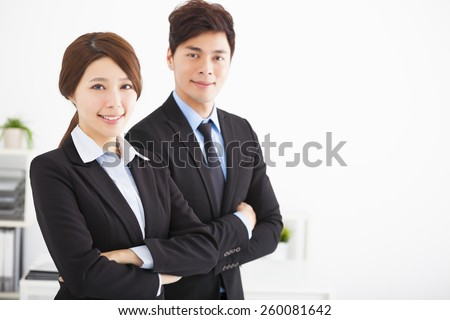 young business man and woman in the office - stock photo