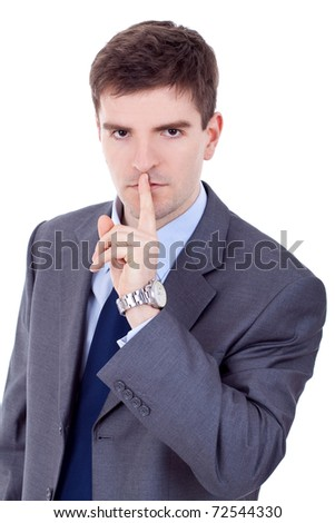 Young business man asks for calm and quiet, over white - stock photo