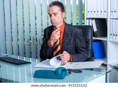 young business man at his desk in summerly hot office - stock photo