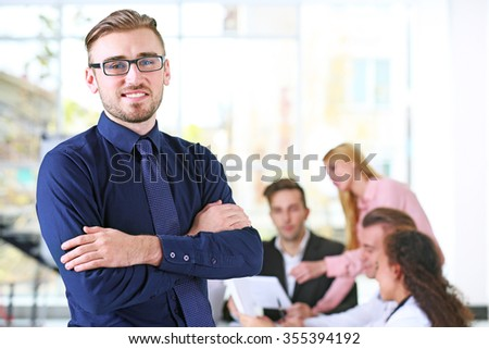 Young business man at the meeting in a conference room - stock photo
