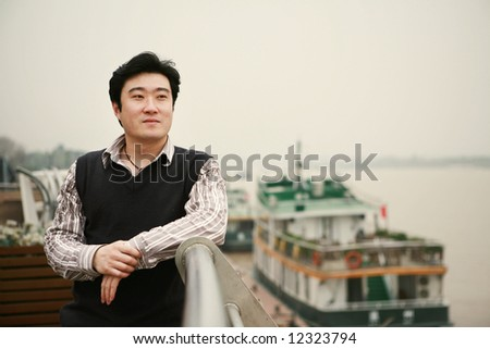 young business man beside steamboat