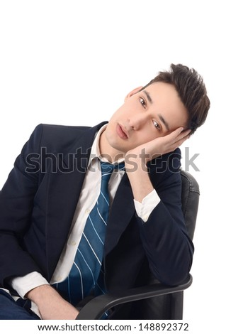 Young business man bored in the chair.  - stock photo