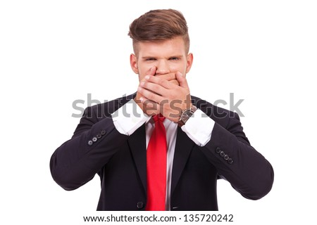 young business man covering his mouth. speak no evil. isolated on white background - stock photo