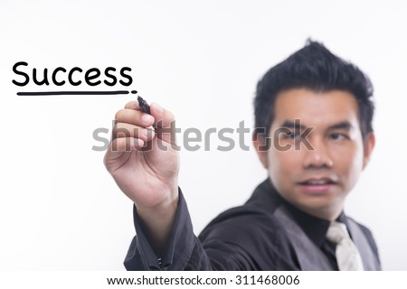 Young business man draws a word success - stock photo