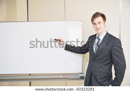 young business man explain at the whiteboard - stock photo