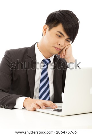 young business man feel tired or angry with laptop  - stock photo