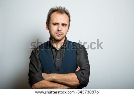 young business man folded his arms crosswise, manager, office style studio shot isolated on the gray background - stock photo