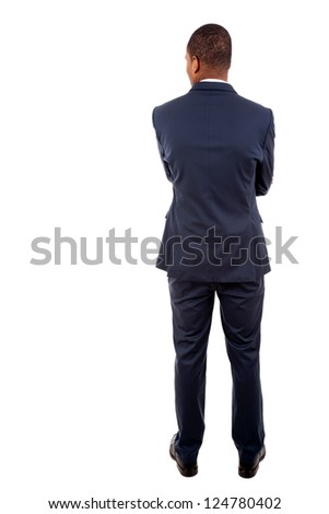 Young business man from the back over a white background - stock photo