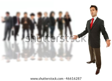 young business man full body isolated with some people on the back - stock photo