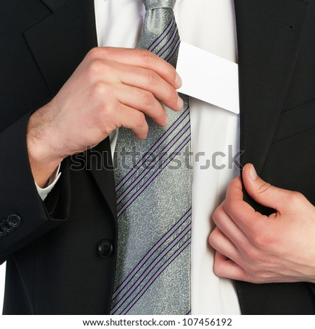 Young business man handing a blank business card