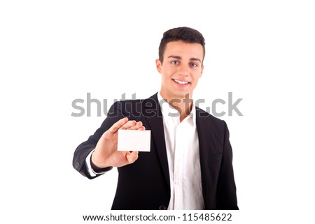 Young business man handing a blank business card over white background - stock photo