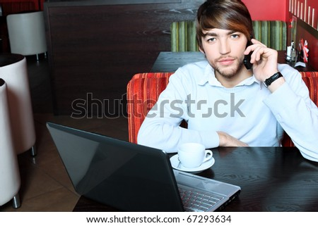 Young business man having a break at a caf - stock photo