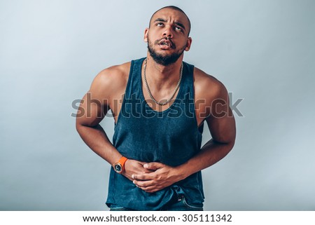 young business man having stomach pain - stock photo