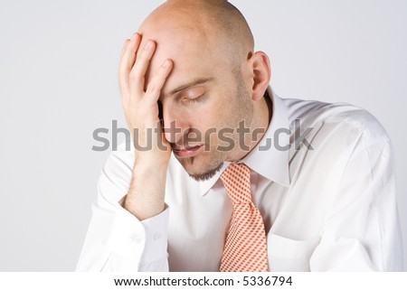 Young business man, head resting on palm, ache - stock photo