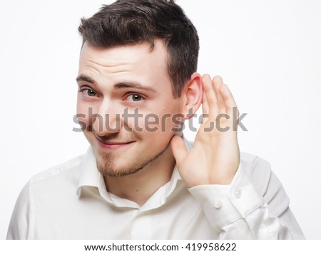 Young business man hearing something