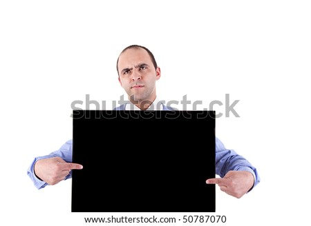 young business man holding a blackboard and pointing with both hands, looking bored, isolated on white background - stock photo