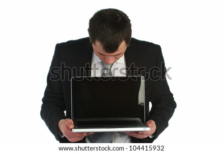Young business man holding a laptop - stock photo