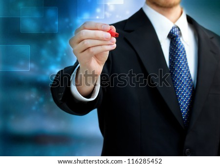 Young business man holding a red pen - stock photo