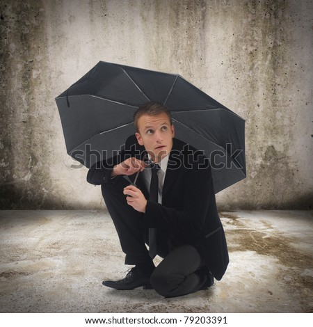 Young business man holding an umbrella