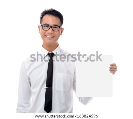 Young business man holding blank billboard