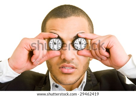 Young business man holding two pocket watches in front of his eyes