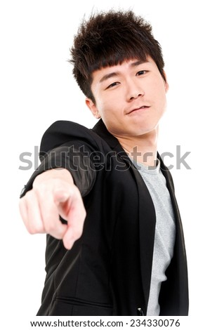 young business man in a suit pointing with his fingers