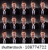 young business man in an arrangement of many funny faces on dark background - stock photo