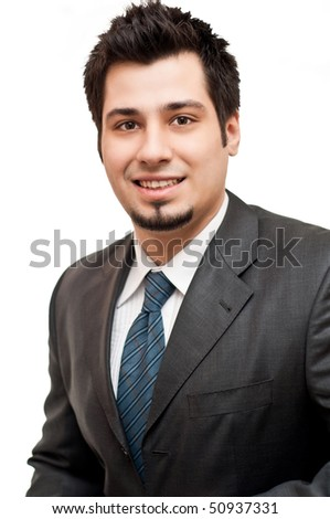 Young business man in suit and tie isolated on white background - stock photo