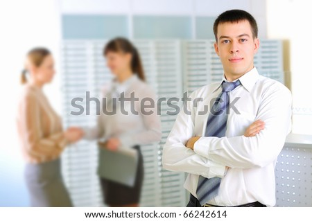 Young business man in the office workplace. - stock photo