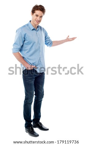 Young business man in welcoming gesture - stock photo