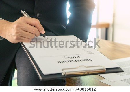 Young Business man insurance agent show document contract to the customer at the table in office