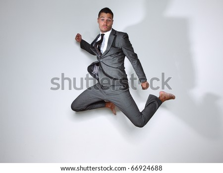 young business man jumps
