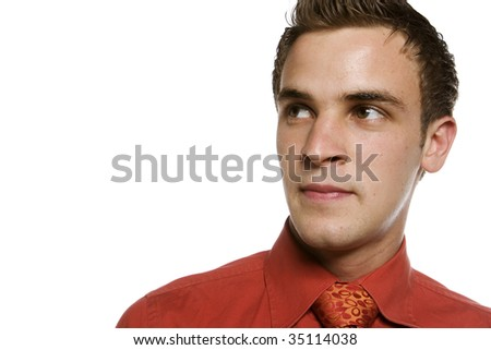 Young business man looking to side away from camera - stock photo